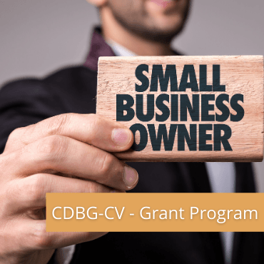 "Small Business Grant logo with a man holding a ""Small Business Owner"" sign."